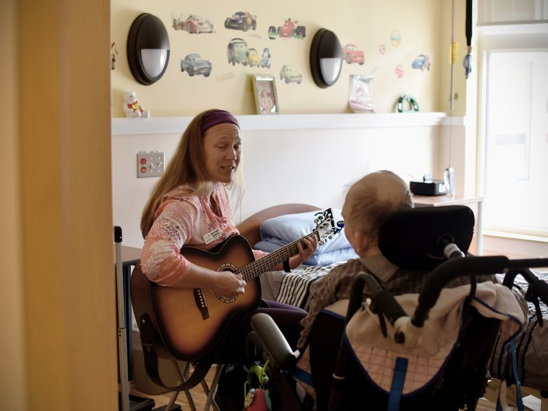 We have a music therapist, who comes and works in both group settings, and one on one with clients, twice monthly